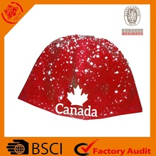 red knitted snowflake earflap hat