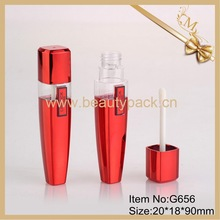 red spraying lip gloss tube with applicator