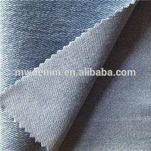 Indigo de punto jean de mezclilla skinny pantalones de las bragas de la tela textil tejido fabricantes