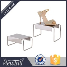 High and low shoe display stand for retail store window showcase