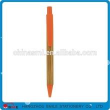 orange plastic ballpoint pen with texture of wood