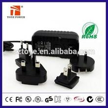 EU UK US AU interchangeable plug power adapter 5v 9v 12V 22v 500ma 0.5a 1a 2a