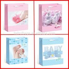 white cardboard material high quality baby gift bag , christmas gift bag ,birthday gift bag,man & lady & cartoon gift bag