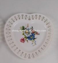 heart-shape hollow white plastic plate