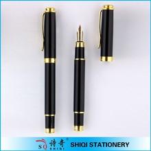gold metal fountain pen