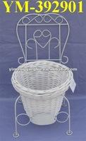 white wicker garden basket with metal chair