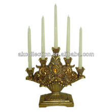 Polyresin antique candlestick w/ 5 taper candles for home decor.