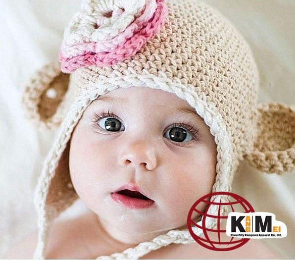 lujo y precioso bebé de punto sombrero del mono con la flor ...