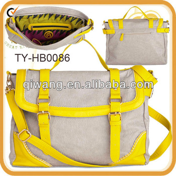 Leather travel bag with bright straps and patterns for women