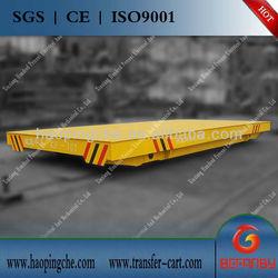 Steel beam transfer vehicle on tracks for handling