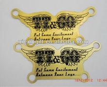hanging brass logo plate