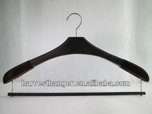 Wooden coat hanger with flocked cover on shoulder in black color