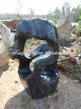 black landscaping stone rocks