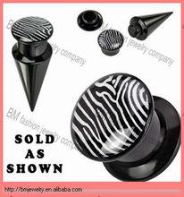 Acrylic black ear taper with zebra logo body piercing jewelry