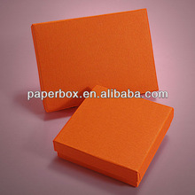 rigid paperboard Luxury red color emboss and silk cotton paper clothing pack box