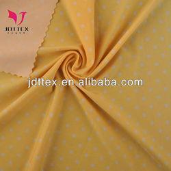 Cute elastic yellow and white polka dot spandex fabric