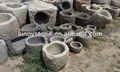 antiguo jardín de piedra redonda ollas