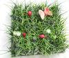 Artificial decorative grass mat with flower