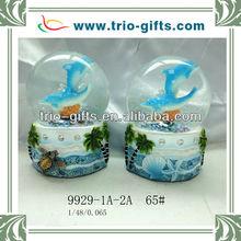 Glass globe polyresin dolphin beach design
