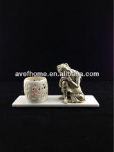 Scroll tealight candlestick with buddha figurine