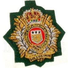 Royal Logistic Corps beret badge - commando green