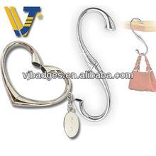travel set heart shape bag hanger for bag