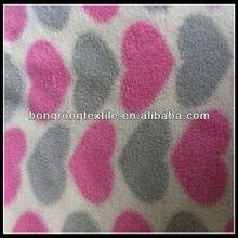 Printed polar fleece fabric with big love doll
