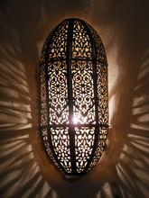Moroccan darken metal Wall Light, Sconce and its openwork brass pattern. Moroccan Arts and Crafts