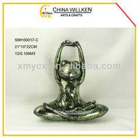 Polyresin yoga frog figurine for sale.