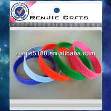 cheap and popular promotional gifts embossed/debossed silicone bracelet 2013 for one direction,welcome OEM/ODM