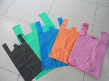 Plain orange HDPE/LDPE T-shirt plastic bags vest carrier bags 28 12x50cm, 18microns