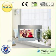 Promotional digital alarm clock with photo frame