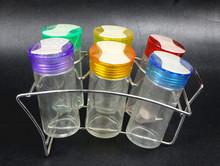 glass cruet set with iron rack