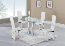 stainless steel dining table with white chairs