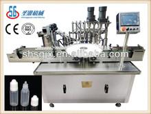 SGGSX- E-juice/e-liquid/e-cigarette liquid filling and labeling machine. shanghai shengguan small bottling equipment.