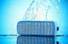 mobile phone computer with mini waterproof bluetooth speaker