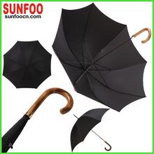 typical wooden curved handle gentlemen umbrella