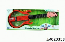 Kids touch music guitar