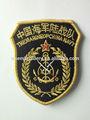 bordado hombro insignia