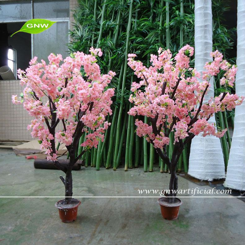 flores artificiais em vasos decorativos para decoração de casamento