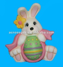 Handpainted ceramic Bunny Rabbit with holding a Pink Ribbon