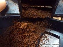 Spray dried instant ground coffee