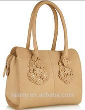 Unique classy ladies handbag with beautiful flower in the handle