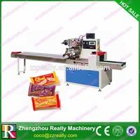China flow pack machine,single twist candy packing machine,horizontal type packing machine