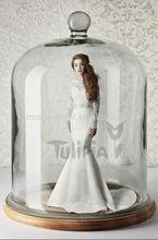 bateau neckline long sleeves open back floor length mermaid wedding dress