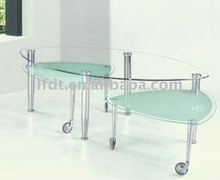 rotating wheels glass coffee table