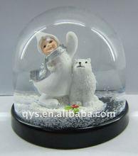 Kid with polar bear snow globe