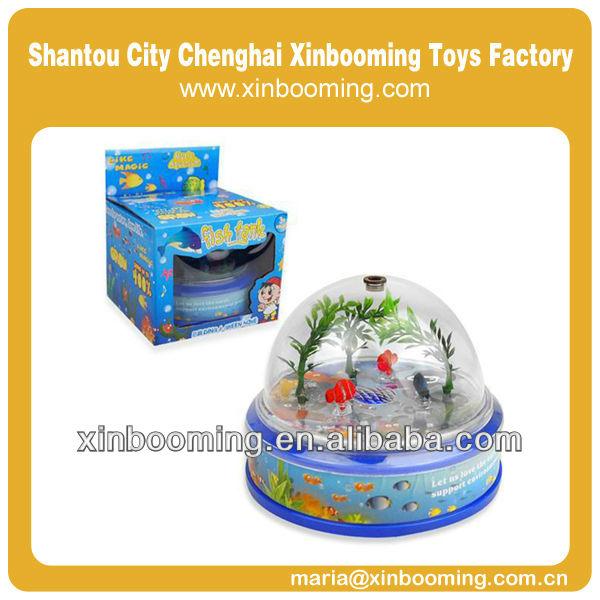 Tanque de peces, juguete de plástico, cilindro peces y la luz y la música conjunto