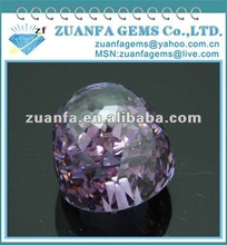 bell shaped purple faceted zircon gemstone