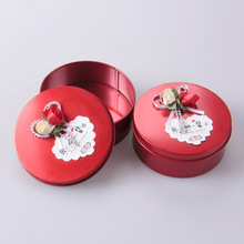 Round shape packaging tin box with Flower adornment
